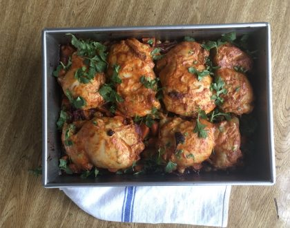 harissa chicken thighs topped with cilantro